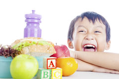 Happy child with school lunch Stock Photo