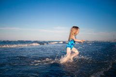 Happy child in the sea royalty free stock image