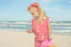 Happy child with sea shell at the beach Stock Photography
