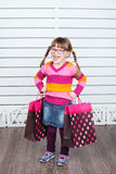Happy child with shopping bags. She is enjoying the gifts and holidays Royalty Free Stock Photography