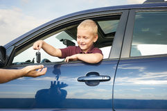 Happy child showing keys from car Stock Photo