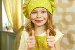 Happy child showing thumbs up. stock photography