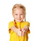 Smiling girl showing thumbs up or OK symbol. Smiling little girl showing a thumbs up or OK symbol. A child wearing a yellow T-shirt.  Isolated on white Stock Photo