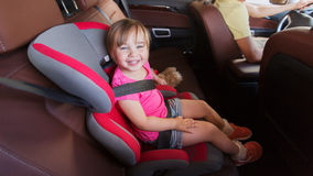 Happy child sitting in car seat and father driving Royalty Free Stock Photos