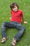 Happy child sitting on the grass Royalty Free Stock Images
