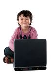 Happy child sitting with a laptop Stock Photos