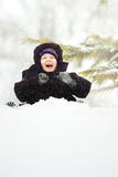 Happy child is sitting in the snow stock photos