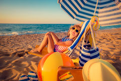 Happy child sitting on the sunbed Royalty Free Stock Images
