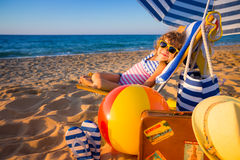Happy child sitting on the sunbed Royalty Free Stock Photo