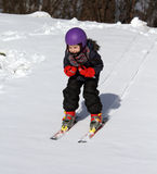 Happy child on ski in winter royalty free stock photo