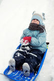 Happy child on sled. Happy child playing on sled Royalty Free Stock Image