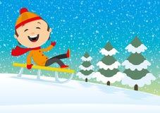 Happy child sledding. Stock Photography
