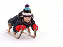 Happy child on sledge in  winter Stock Photo