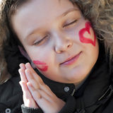 Happy child sleep. With valentines heart on cheek Royalty Free Stock Image