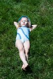 Happy child sleeping on green grass Royalty Free Stock Photo
