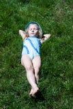 Happy child sleeping on green grass Royalty Free Stock Photo