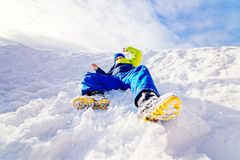 Happy child sliding from little snowy hill Stock Photography