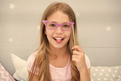 Happy child or small girl with party glasses. happy child posing with paper glasses. small girl with smile on face royalty free stock photo