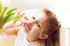 Happy child smelling beautiful flower Royalty Free Stock Photo