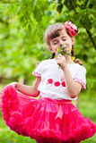 Happy child smelling wildflowers Stock Images