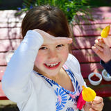 Happy child smiling at camera and eating ice cream Royalty Free Stock Photography