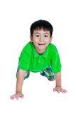 Happy child smiling and crawling on knees. Isolated on white bac. Happy child smiling and crawling on knees. Stylish asian boy having fun at studio. Isolated on Royalty Free Stock Images