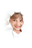 Happy child smiling in torn paper hole isolated Stock Photography