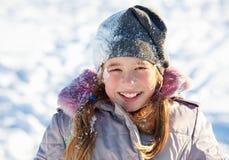 Happy child in snow Stock Photo