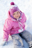 Happy child in snow Royalty Free Stock Image
