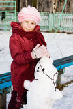 Happy child with snowman Royalty Free Stock Photography