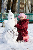 Happy child with snowman Stock Photo