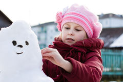 Happy child with snowman Royalty Free Stock Images
