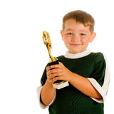 Happy child in soccer trophy Royalty Free Stock Images