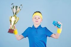 Happy child sportsman hold champion cup trophy. Fitness and diet. Energy. Gym workout of teen boy winner. Success trophy. Childhood activity. Sport and health stock images