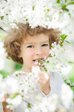 Happy child with spring flower Stock Photo