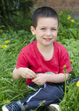 Happy child at spring grass Royalty Free Stock Photography