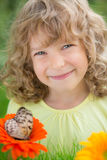 Happy child in spring park Stock Image