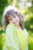 Happy child in spring park. Happy child playing outdoors in spring park Stock Image