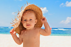 Happy child with straw had on beach on family vacation Royalty Free Stock Images