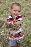 Happy child with straw or hay Royalty Free Stock Photography