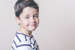Happy child. With striped shirt Stock Image