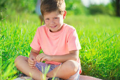 Happy child studying on nature. With books Stock Images