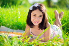Happy child studying on nature Royalty Free Stock Photos