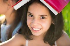 Happy child studying on nature Stock Photo