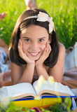 Happy child studying on nature. With books Royalty Free Stock Image