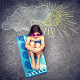 Happy child in summer camp. Cute little baby girl having fun outdoors, drawing on asphalt sun and tanning under it, happy childhood in summer camp, active stock photo
