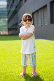Happy child with sunglasses. Happy child with trendy sunglasses in urban environment Stock Photography