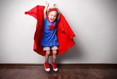 Happy child in superhero suit Royalty Free Stock Photos