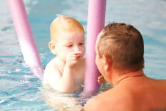 Happy child in a swimming pool royalty free stock photos