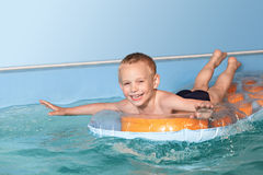 Happy child in a swimming pool. Royalty Free Stock Photo